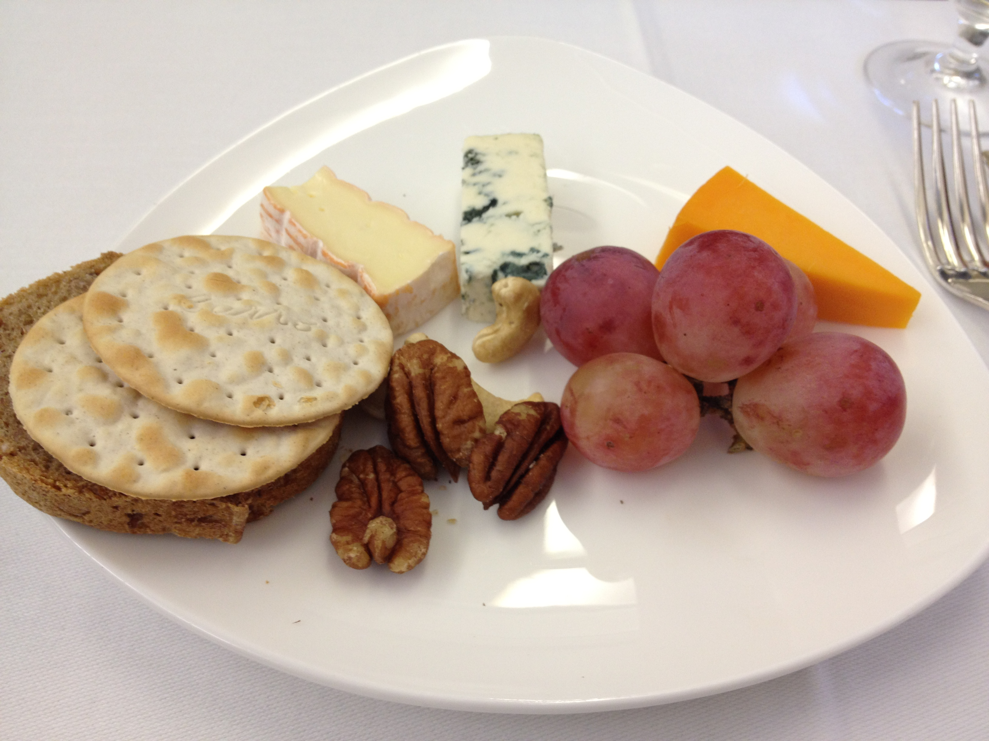 Cheese, crackers, fruits, and nuts