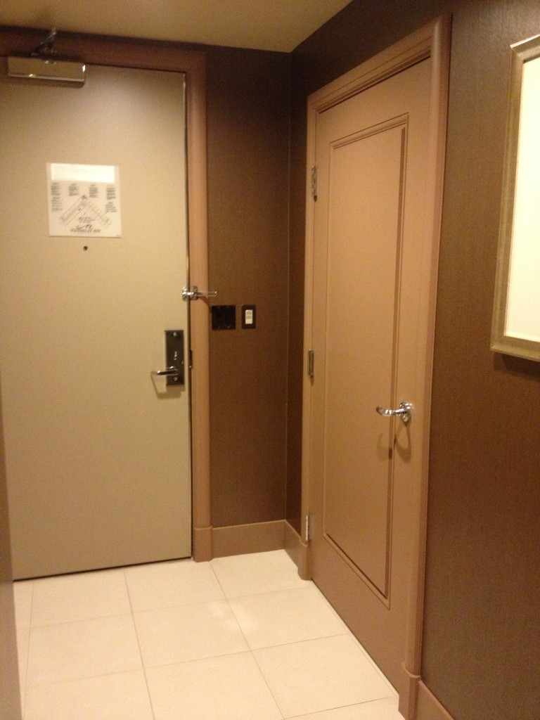 The entry door is on the left, and the powder room door is on the right.