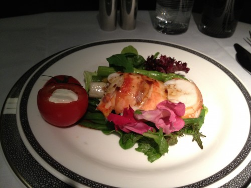 A very healthy serving of lobster on top of the salad.