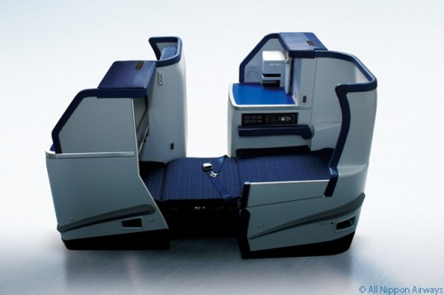 ANA has a lie-flat seat in a private 1-2-1 configuration. Should be great!
