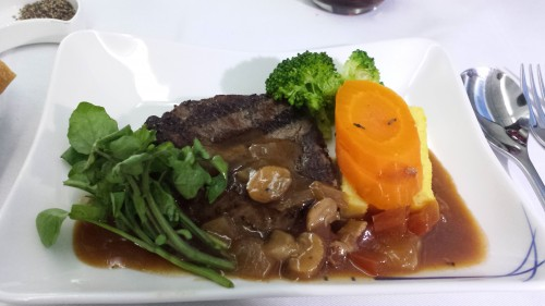 The main course, which was steak with either pancetta and tomato sauce or daikon radish soy sauce. I had the tomato sauce. The steak tasted fine, but reminded me of something I'd have in economy.