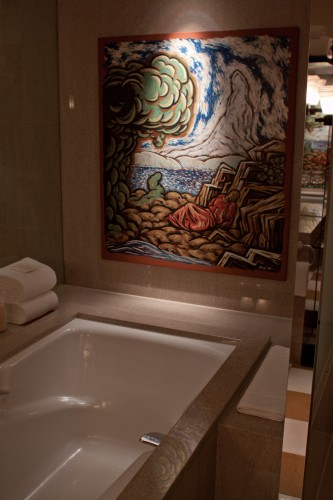 Artwork above the bathtub.