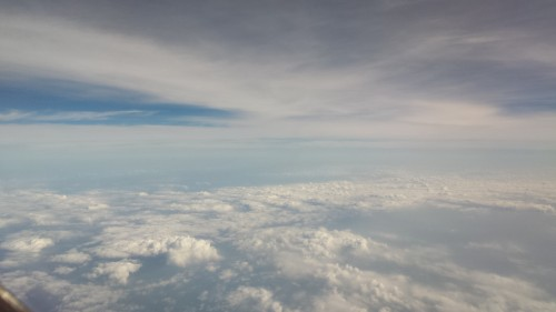 There's something cool about seeing clouds above and below...