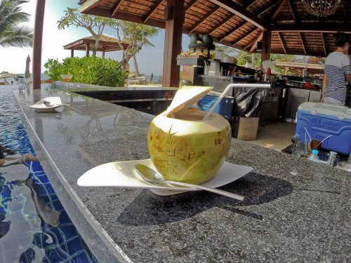 Enjoying a coconut at the community pool's bar!